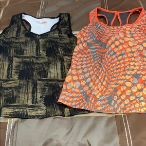 Two athletic sport tanks